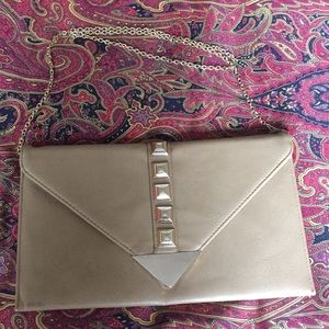 Tan clutch with metal chain